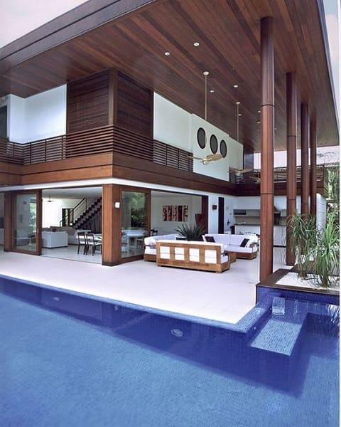 Projeto de Casa de Praia: varanda com pé direito alto