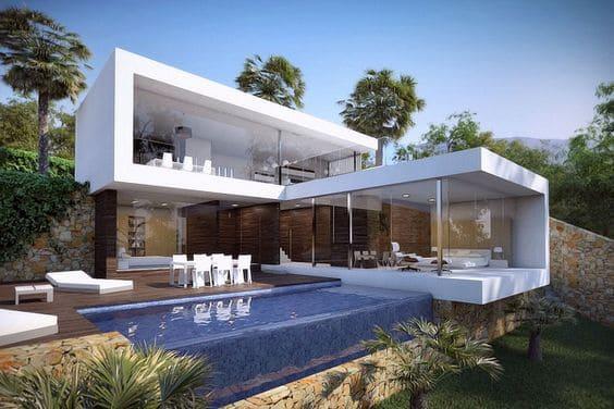 Piscina de Vidro em casa integrada com a natureza (foto: Pinterest)