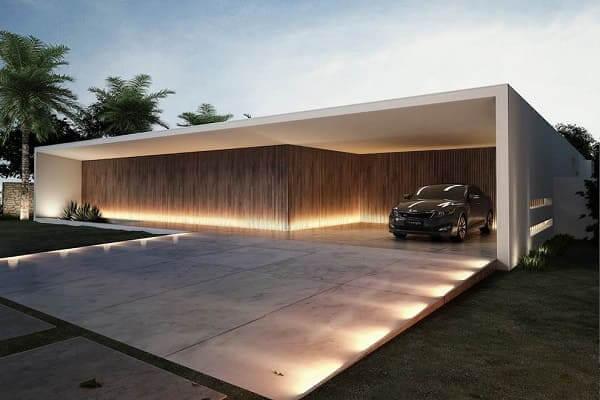 Fachadas de casas térreas com garagem na frente: garagem sem portão é proposta moderna