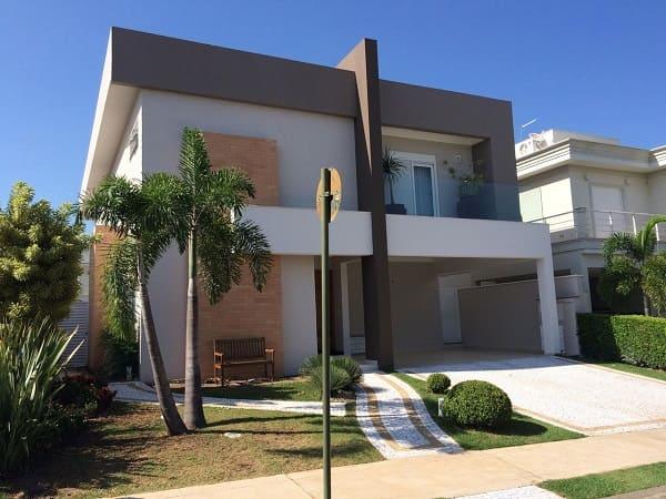 Casa quadrada: fachada preta e branca com tijolinhos (fonte: Revista Viva Decora)