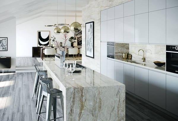 Balcão de mármore na cozinha: branco traz elegância e amplitude para o espaço (projeto: Cosentino)