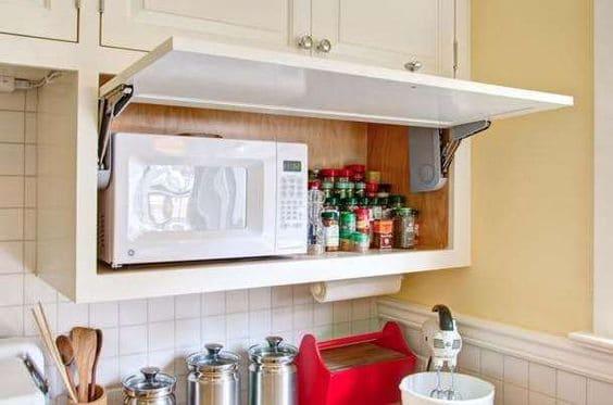 Passa prato: microondas escondido