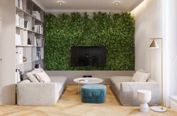 Muro verde atrás da TV na sala de estar (foto: Revista Viva Decora)