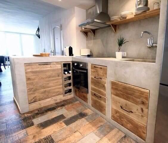 Móveis de Alvenaria: bancada de concreto com gavetas de madeira (foto: Revista Viva Decora)