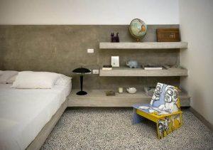 Móveis de alvenaria cabeceira de concreto aparente projeto Jordi Puig
