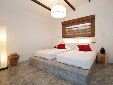 Móveis de alvenaria: cama de alvenaria com concreto aparente (foto: Dicas de Arquitetura)