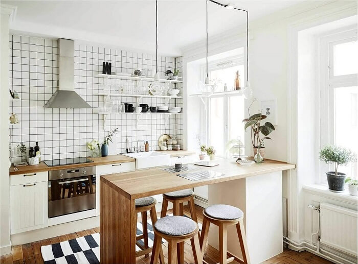 Estilos de cozinhas: modelo de cozinha escandinava com bancada de madeira. Fonte: Bartz Móveis Planejados
