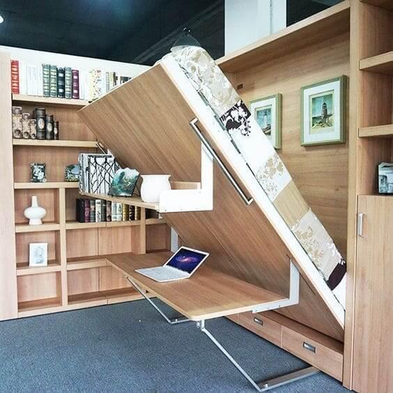 Móveis multifuncionais: cama embutida no armário com mesa de home office (foto: Pinterest)