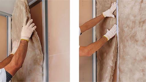Aplicação de lã de vidro em parede de drywall (foto: Ciamon)