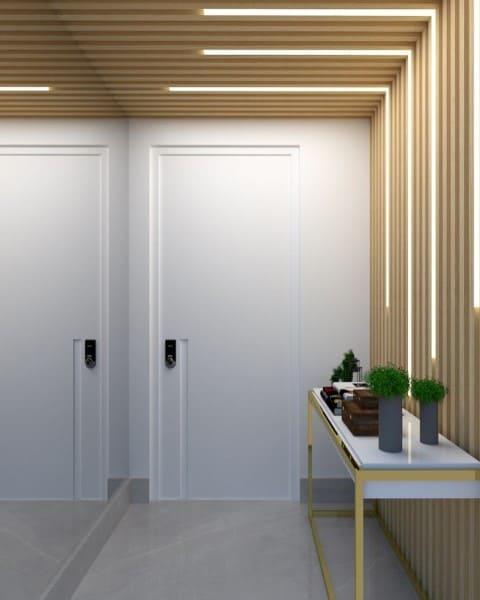 Perfil de LED em hall de entrada com ripado de madeira (foto: Studio 19)