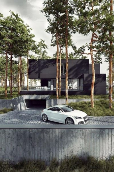 Garagem subterrânea em casa moderna com fachada preta (foto: Futurist Architecture)